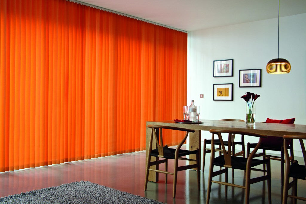 Bright orange vertical blinds in a dining room