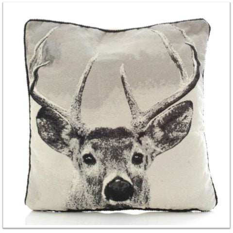 Cream cushion with large stag face printed design