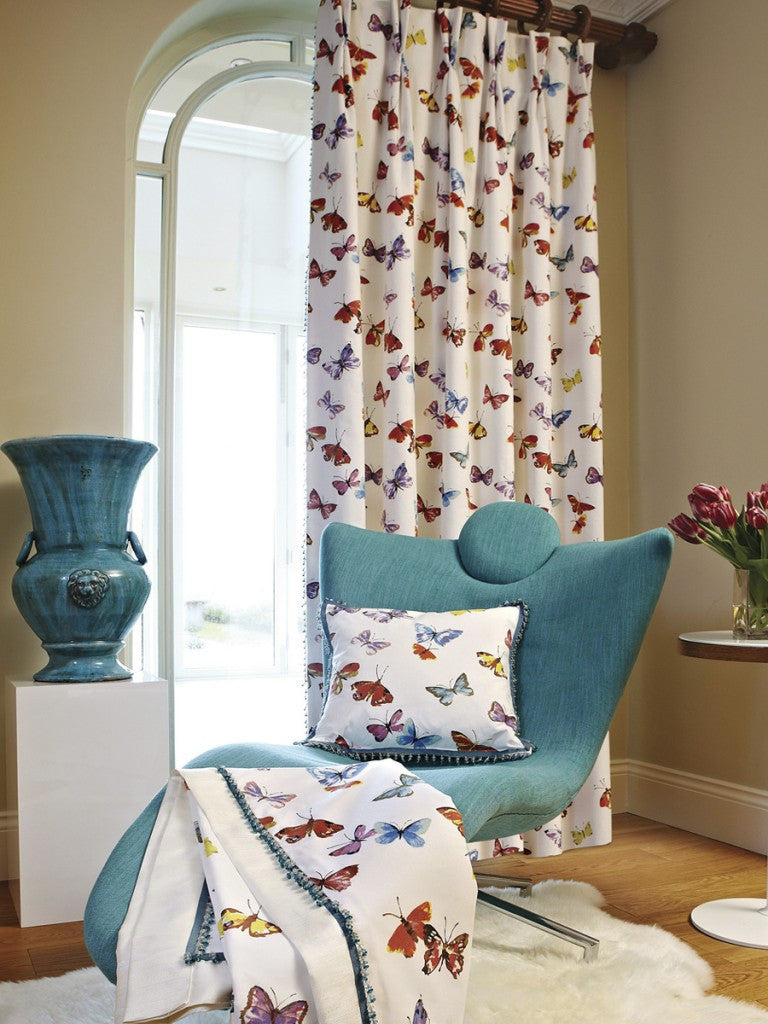 Sweet colourful butterfly design on cream curtains and matching cushion