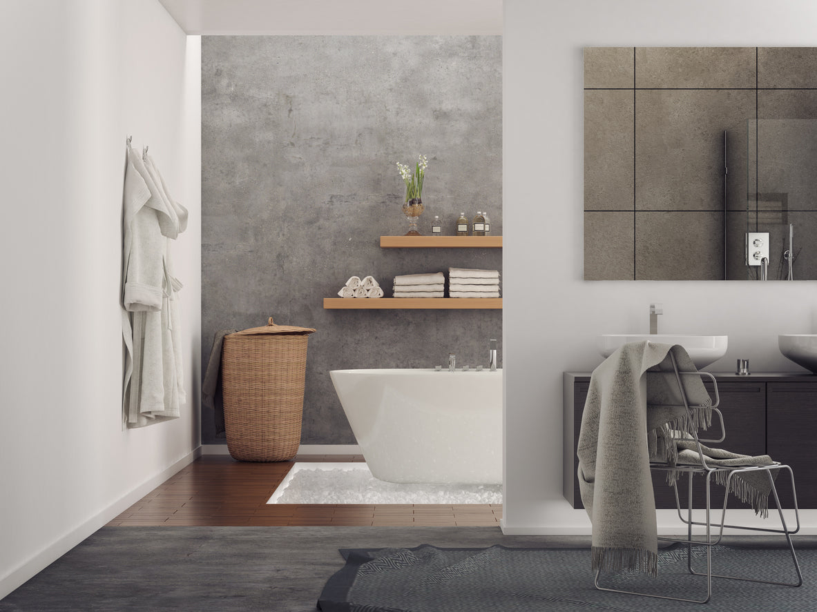 Modern bathroom with grey concrete wall classy white bathtub and in the foreground a think