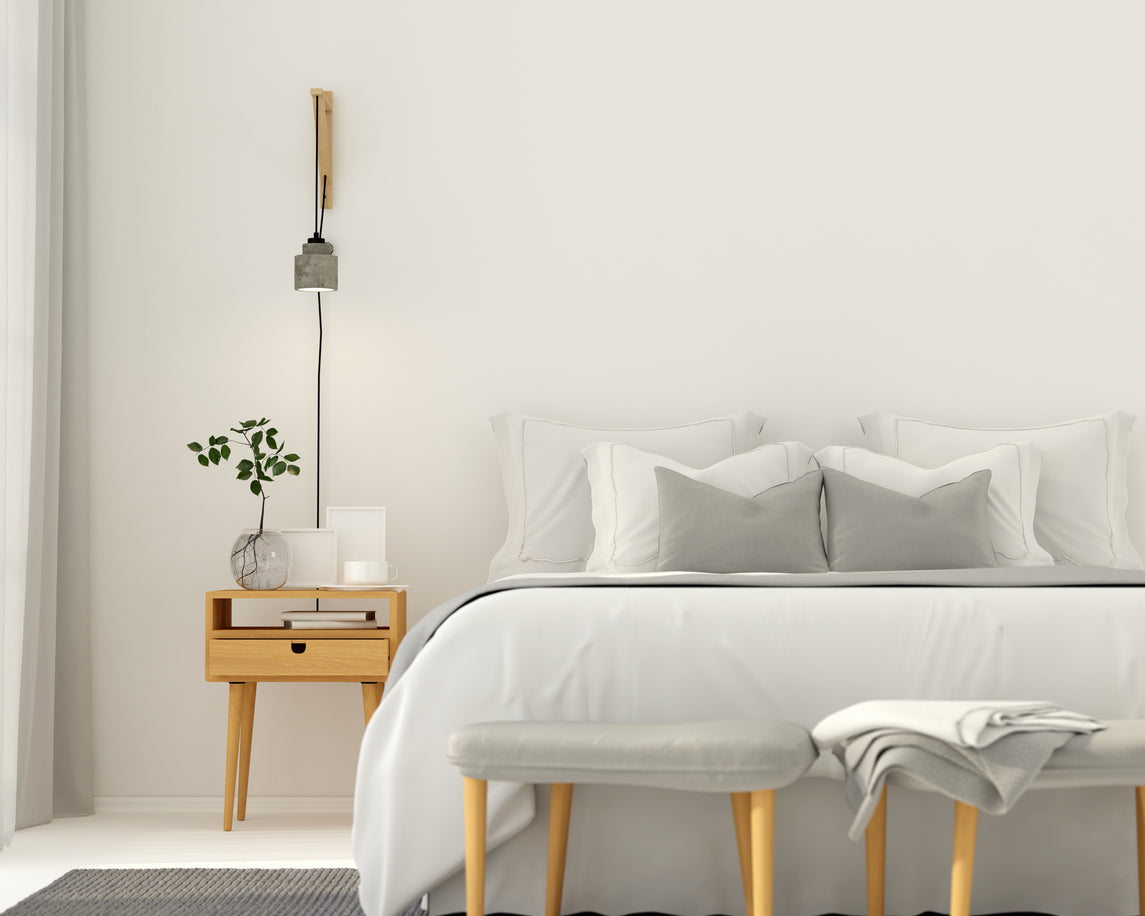 White bedroom with grey bed cushions