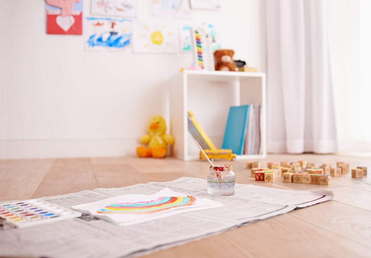 Childrens Painting Of A Rainbow Is Left On The Floor Of A Childs Bedroom