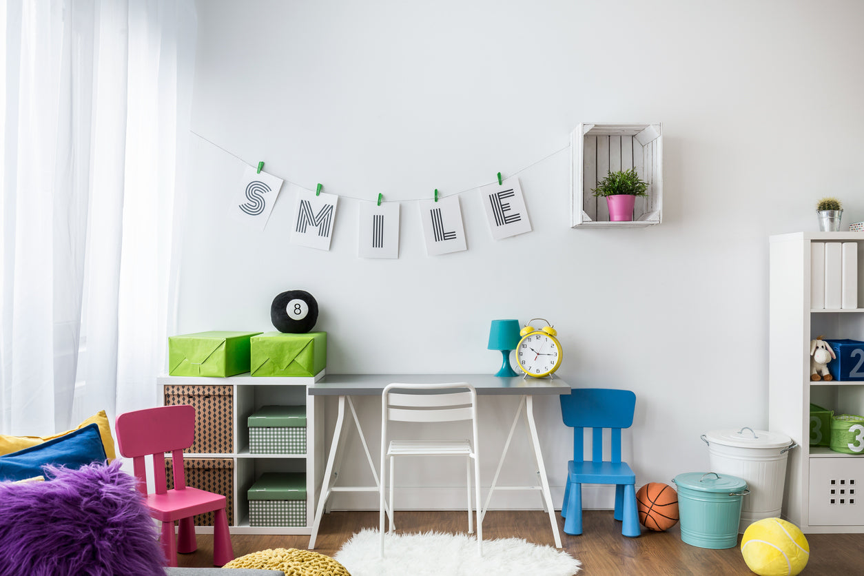 Fresh And Bright Childs Room With Bold Blues, Pinks And Greens Used For Accessories