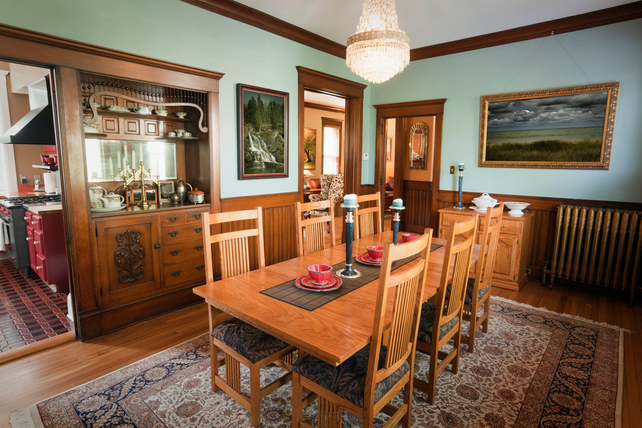 Traditional wooden table in a traditional dining room with matching decor