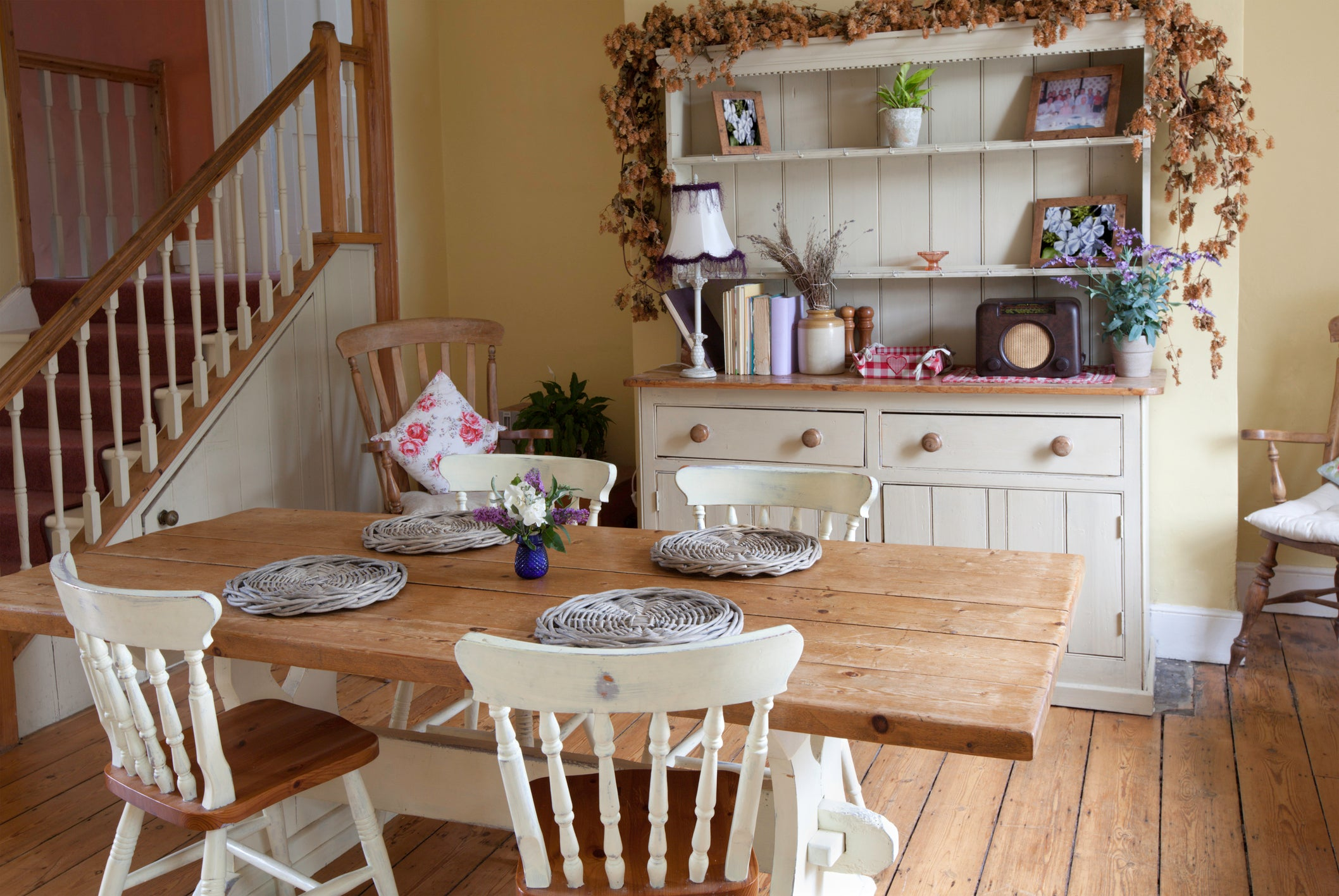 Rustic farmhouse kitchen with wooden table and cream welsh dresser