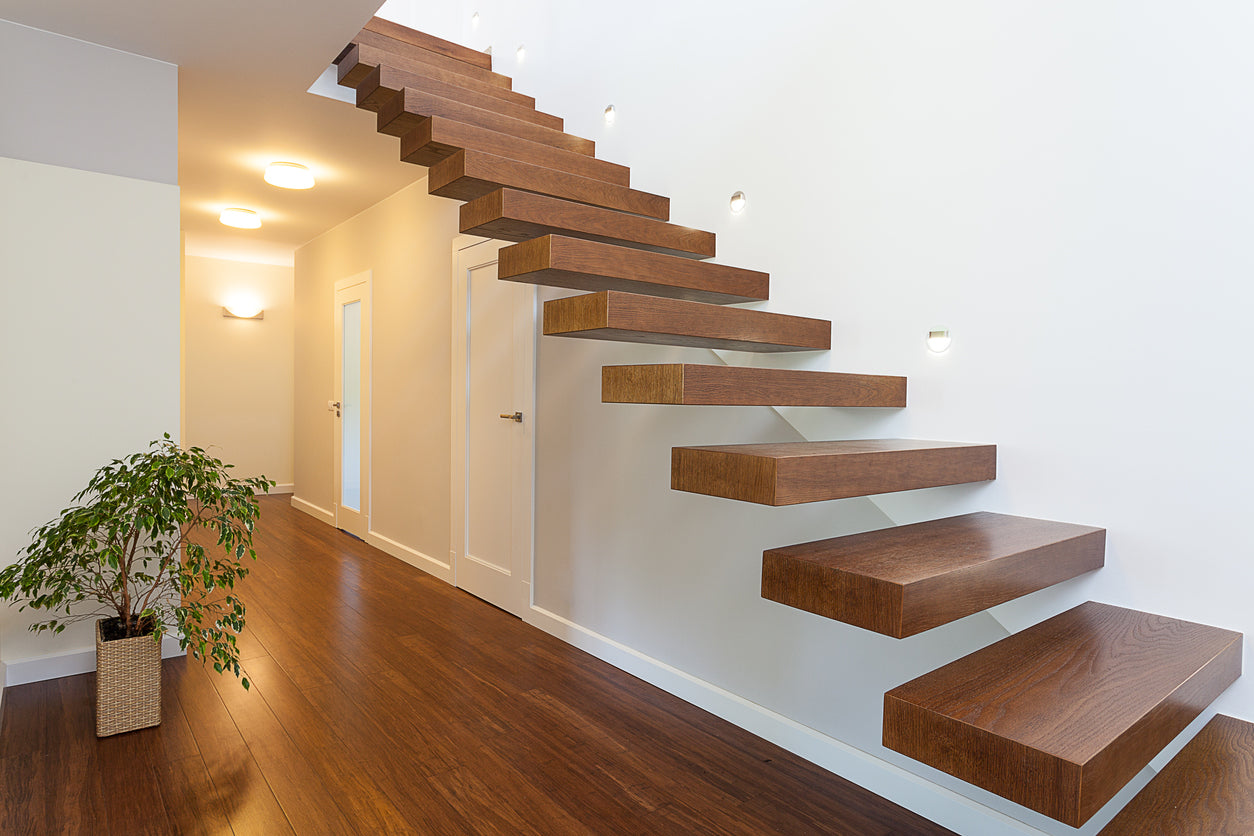 White hall with floating step staircase in natural wood