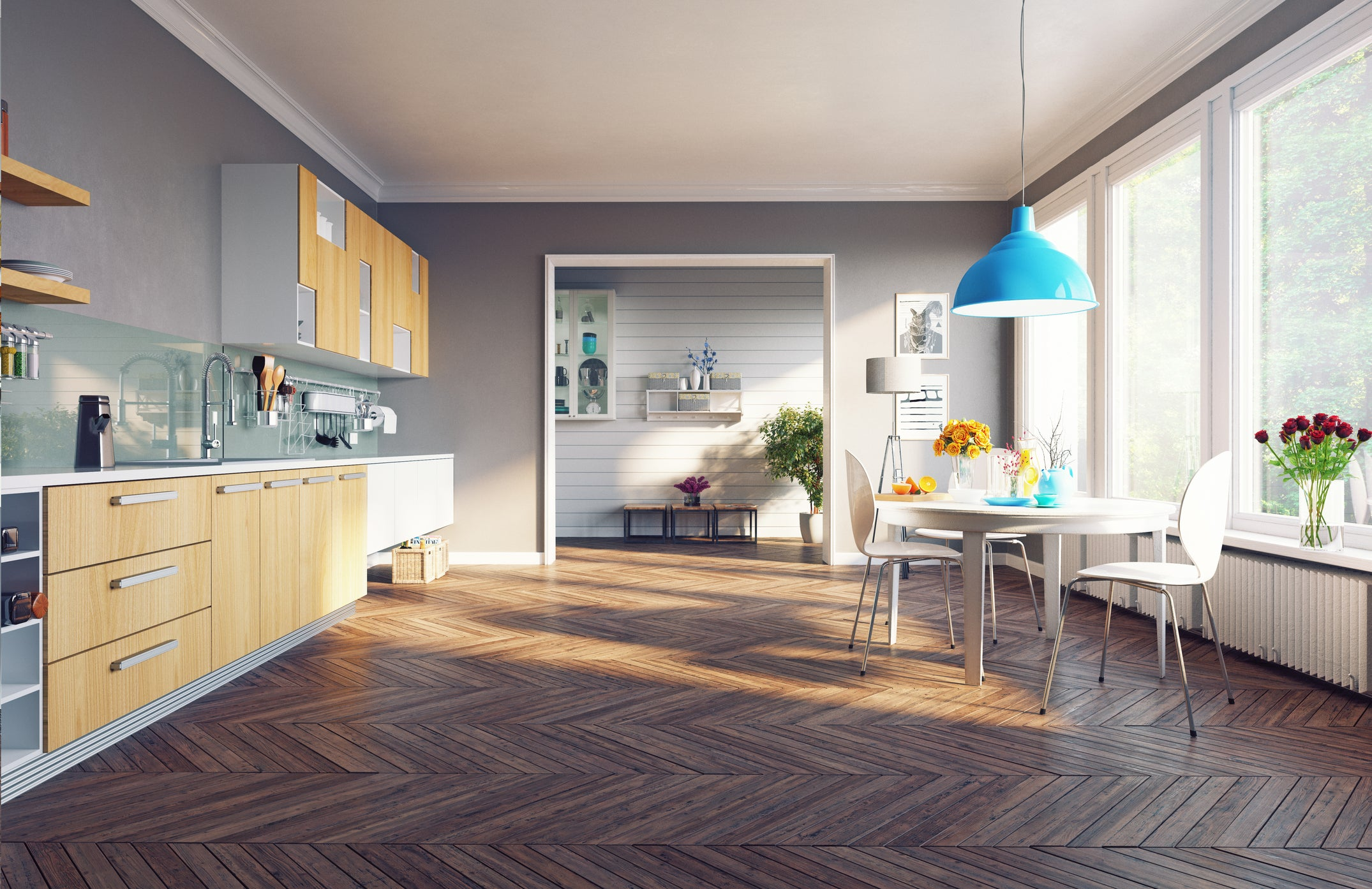 Spacious kitchen with grey walls and herringbone wooden flooring