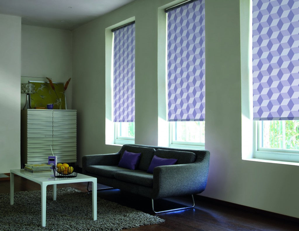 Purple geometric roller blinds in a living room