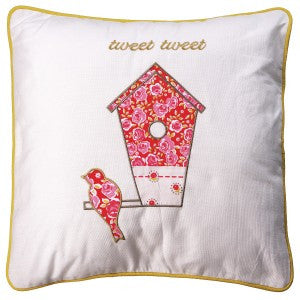 Cream cushion with a red birdhouse design