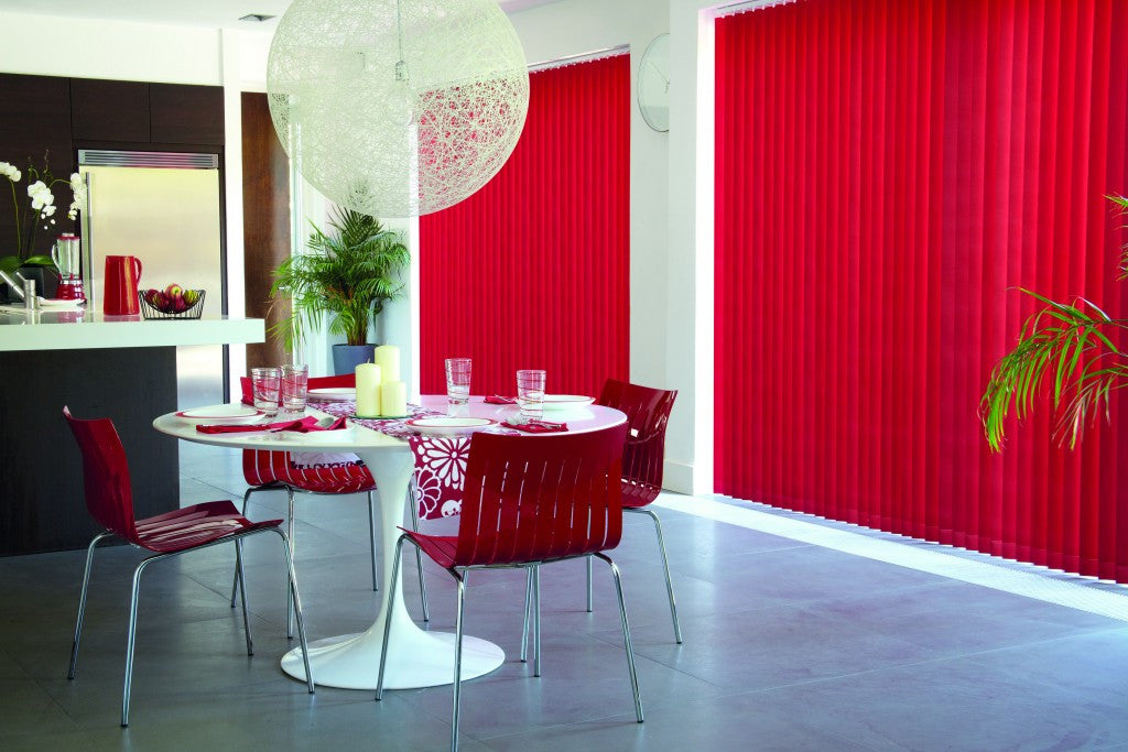Dark red vertical blinds in a dining room