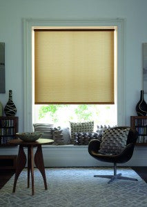Beige roller blind in a dark office living space