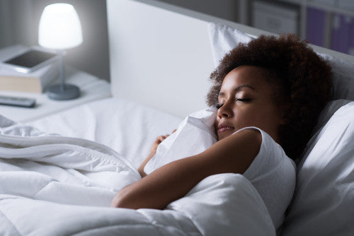 Young Woman Sleeping With Light On