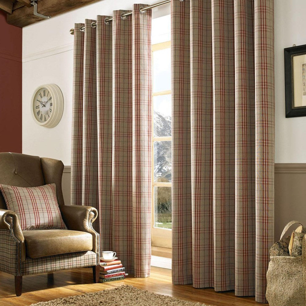 Beieg and red tartan eyelet curtains hung at a window