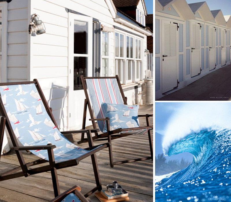 Beach deck chair in front of beach huts