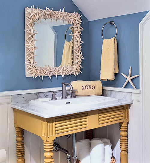 Funky Shell Mirror Frame In A Blue Nautical Themed Bathroom