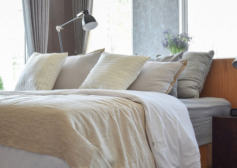 Cream, Grey And Beige Bedding On A Bed
