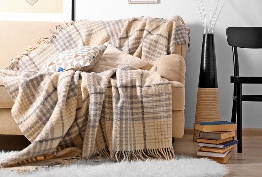 Beige Tartan Throw On Top Of A Beige Sofa