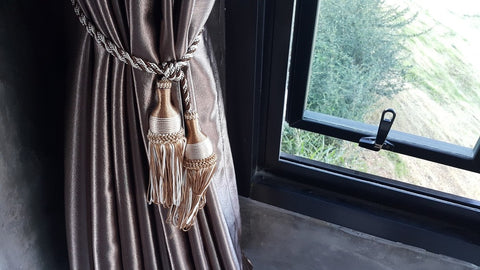 Curtain Tied Back In Window