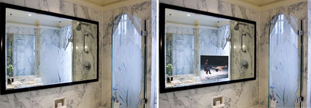 White marble with black swirling lines covering the walls of a bathroom with smart mirror and TV screen above the sink