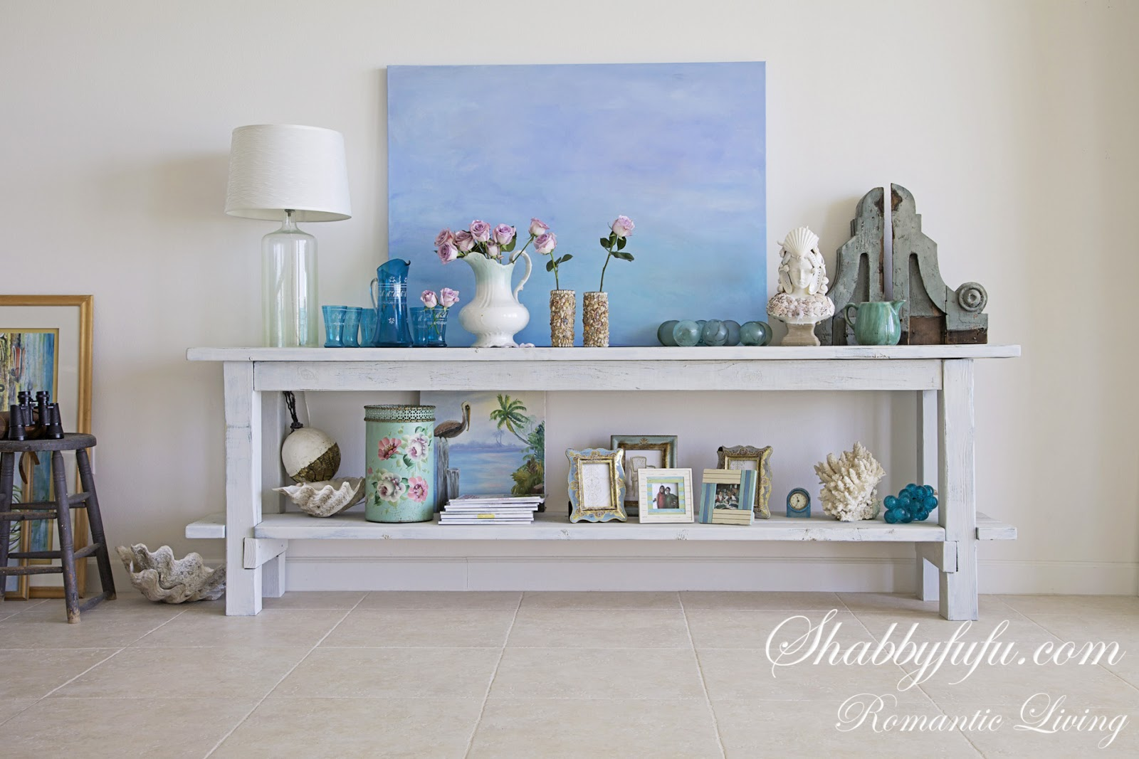 Rustic beach style shelf unit with light blue and cream accessories