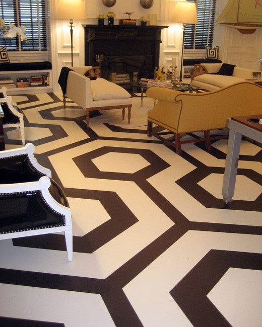 Black and white geometric hexagon flooring in a living room