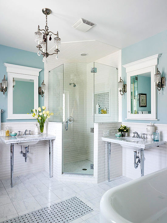 White tiles and light blue walls in a modern and fresh bathroom