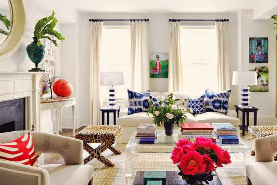 A large cream living space, with cream and beige furniture and touches of blue and white with accessories