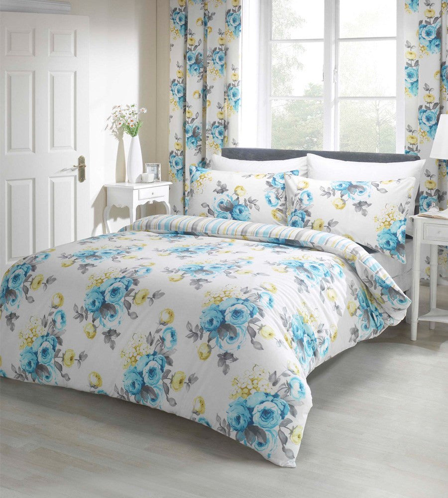 White bedding with a vivid blue and yellow floral pattern