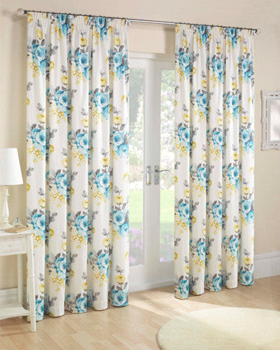 Cream curtains with a vivid blue and yellow floral design