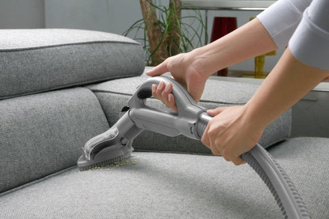 Grey Sofa Being Vacuum Cleaned
