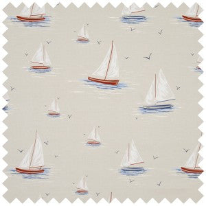 Swatch of cream fabric with sail boats