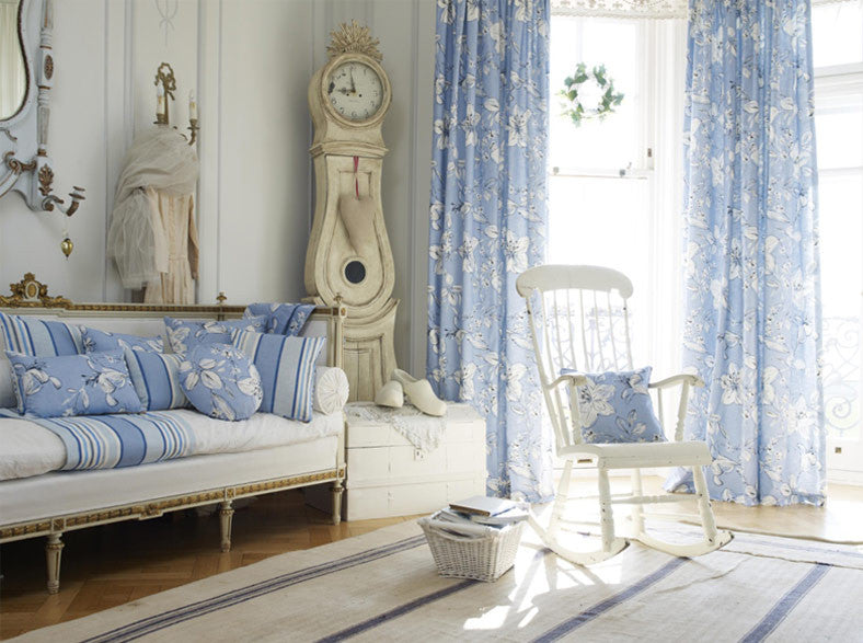 Beach hut style living space with lots of light blue and cream