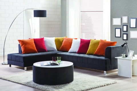 Alternating Cushions Colours On A Blue Corner Sofa