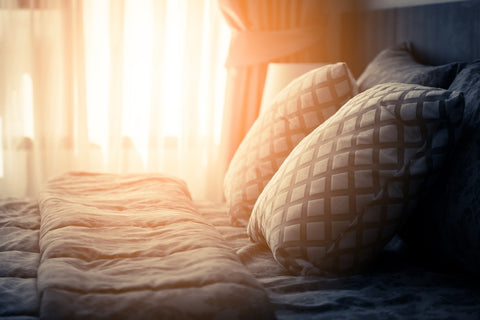 Sunshine Through Voile Panels Lighting A Made Bed