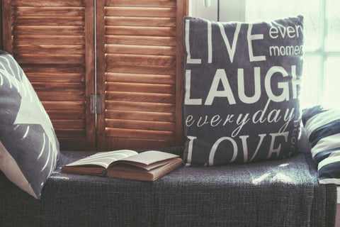 Live And Laugh Cushion On a Stylish Window Bench