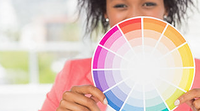 Woman holding up a colour wheel