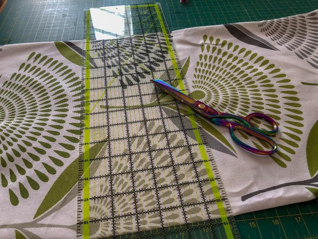 Fabric on table with ruler and scissors