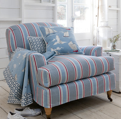 Blue, white and red pin striped chair in a beach house