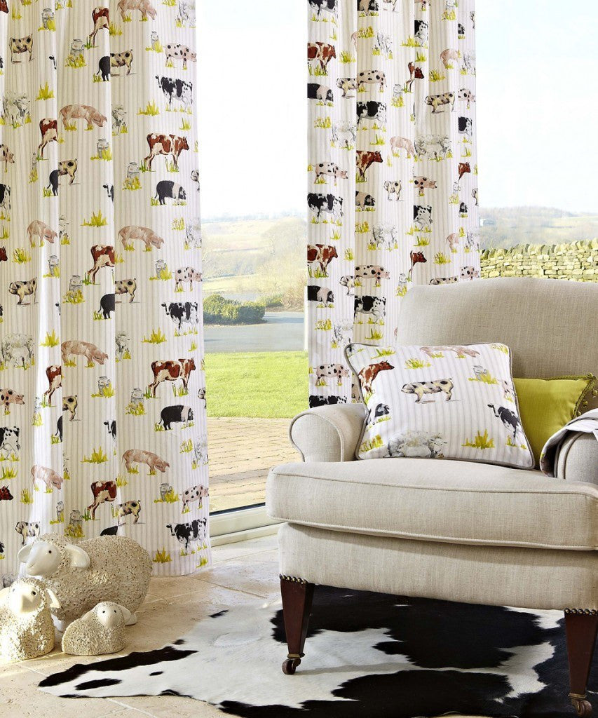 Farmyard animals pattern on cream curtains and matching cushion