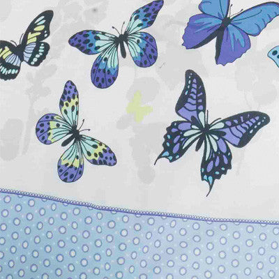 Close up of blue butterflies on white bedding