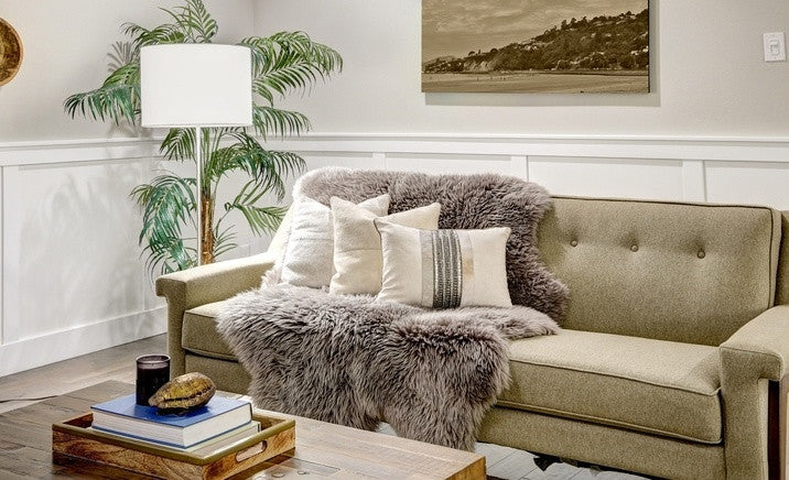 Faux Fur Throw Over A Very Light Green Sofa