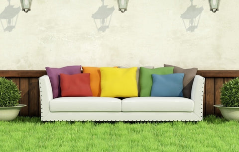 Sofa In The Garden, Adorned With A Rainbow Of Cushions