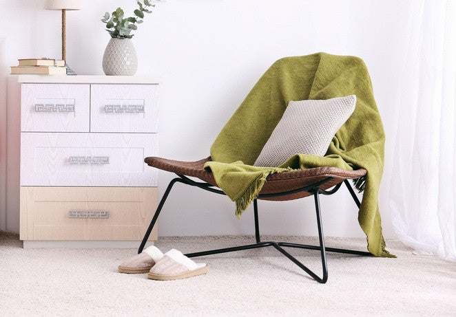 Green Throw On Funky Desk Chair, Next To Bedside Drawers