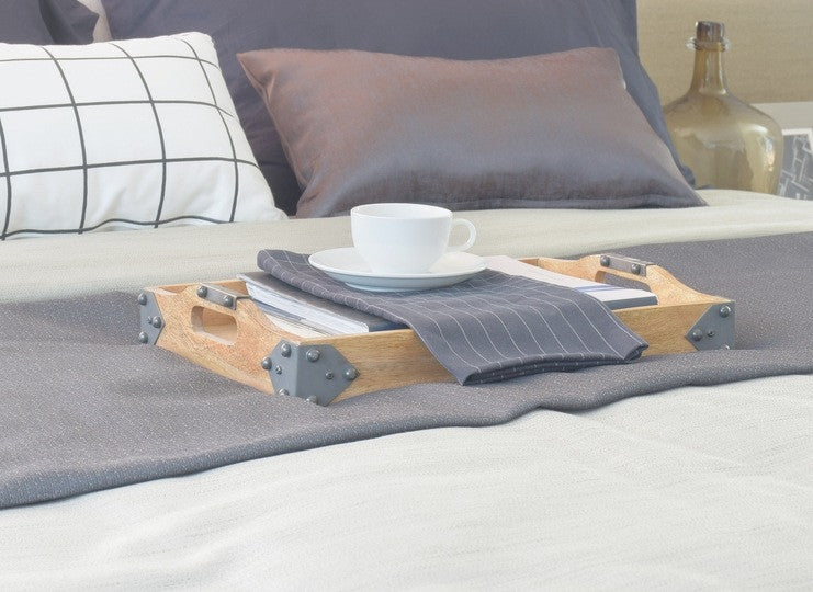 Tea Tray On A Bed On Top Of A Grey Bed Runner