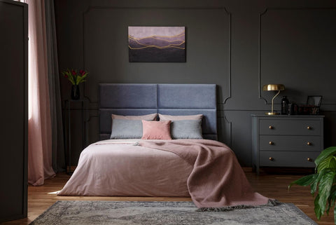 Grey bedroom with a pink bed