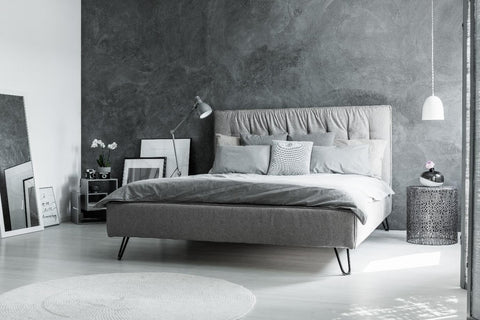 Grey bed in a a grey bedroom