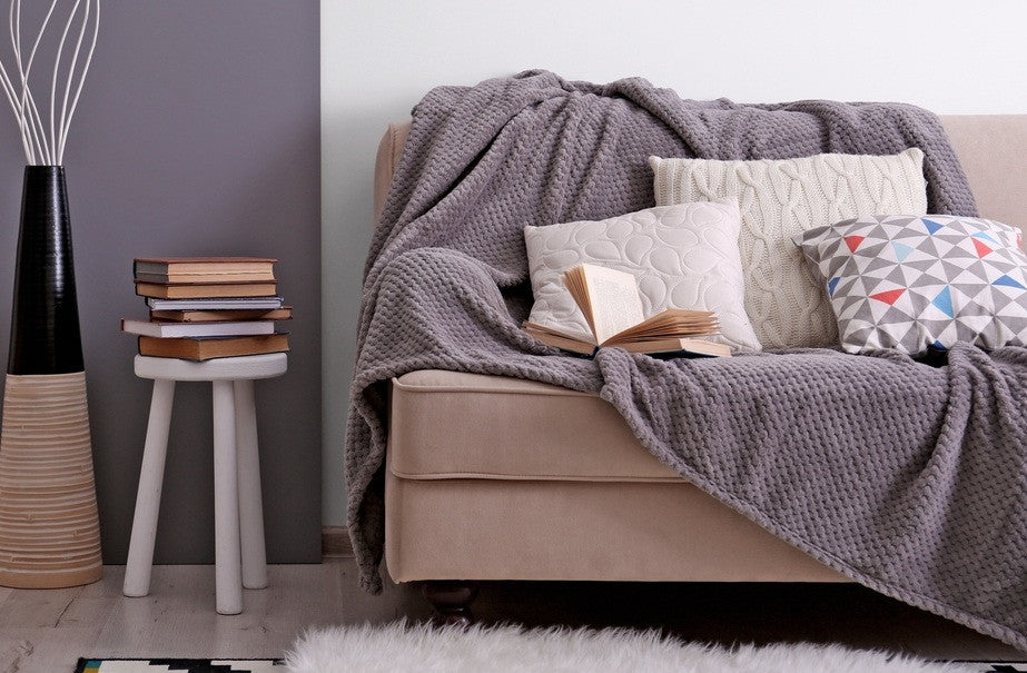 Grey Throw Over A Beige Sofa, With Three Matching Cushions