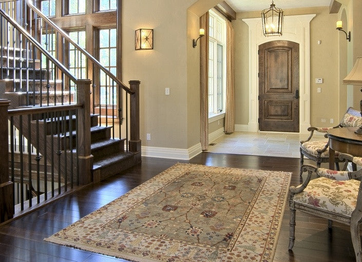 Traditional Rug In A Classy Hallway, Next To A Wooden Staircase
