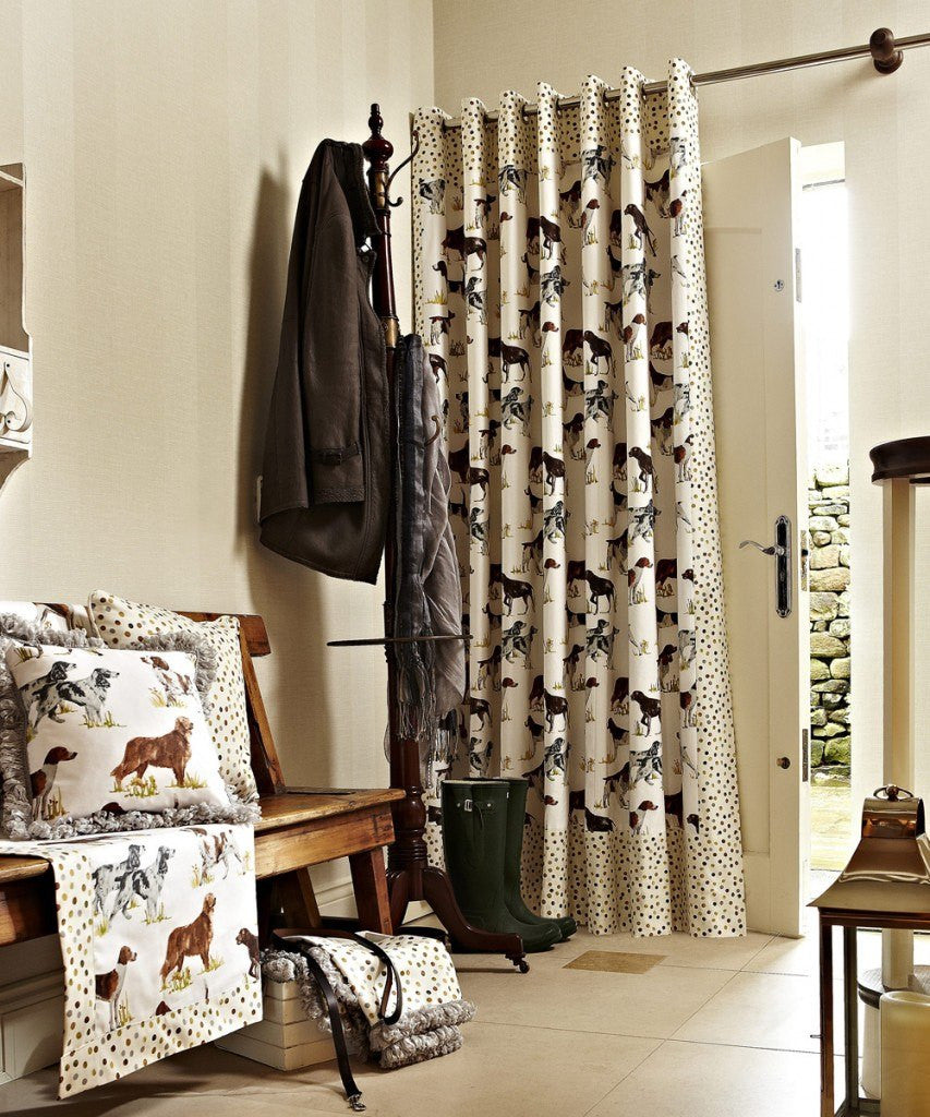 Cream eyelet curtains with hounds and dogs pattern