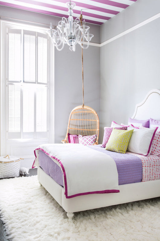 White and grey bedroom with white, pink and purple bedding